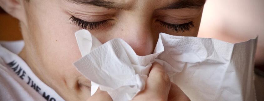 sneezing is a symptom of allergies